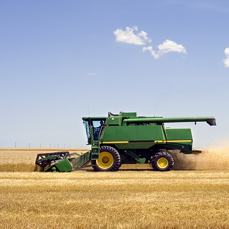 Green-combine-harvester-in-field.jpg